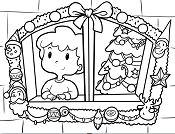 Boy celebrating Christmas looks through the window