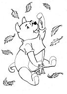 Little Bear with leaves fall in the autumn